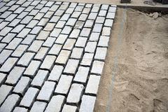 Paving a street with cobblestones Stock Photos
