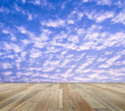 Paving wood floor with cloud and blue sky Stock Image