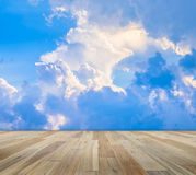 Paving wood floor with cloud and blue sky Stock Images