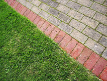 Paving2. Landscape photo of edge of brick path on grass verge stock images