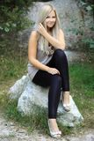Pavlina 11. Beautiful girl sitting on a stone Stock Image