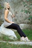 Pavlina 12. Beautiful girl sitting on a stone Royalty Free Stock Photography