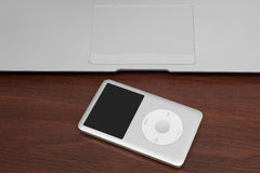 Pavlograd, Ukraine - December 4, 2014: iPod classic 160 Gb on si. Lver metal laptop. Studio shot, isolated on white background Royalty Free Stock Photography