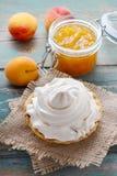 Pavlova cake filled with peach jam Stock Photos