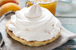 Pavlova cake filled with peach jam Stock Photography