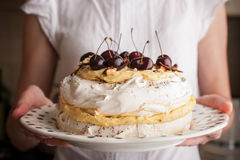 Pavlova cake with fresh cherry  in the woman hands horizonta Royalty Free Stock Photos