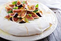 Pavlova cake with fresh figs and orange zest. Pavlova cake with fresh figs, white chocolate, ricotta cream and orange zest Royalty Free Stock Images