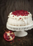 Pavlova cake with pomegranate. Royalty Free Stock Photo