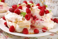 Pavlova cake with raspberries. Meringue  pavlova cake with whipped cream,caramel and fresh raspberries Royalty Free Stock Image