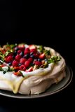 Pavlova cake with tonka cream and berries Royalty Free Stock Photos
