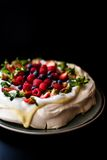 Pavlova cake with tonka cream and berries Stock Photo