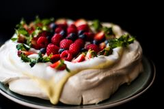 Pavlova cake with tonka cream and berries Royalty Free Stock Photography