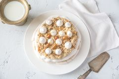 Pavlova Cake With Caramel And Almonds Stock Images