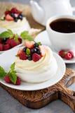 Pavlova cakes with cream and fresh berries Royalty Free Stock Photo