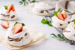 Pavlova cakes with cream and fresh summer berries. Valentines day dessert concept stock photography