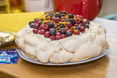 Pavlova. With cream, strawberries, raspberries and blueberries on the top stock photography