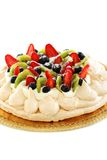 Pavlova dessert with berries and kiwi. Royalty Free Stock Images