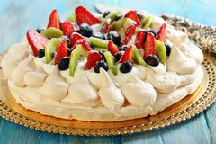 Pavlova dessert and blade for cake. Royalty Free Stock Photo