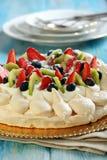 Pavlova dessert with fresh berries. Royalty Free Stock Images