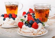 Pavlova dessert with herbal tea Stock Photo