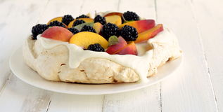 Pavlova with fresh fruit and berries Stock Images