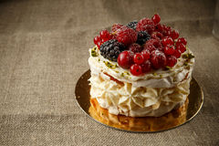 Pavlova, a home made cake from layers of meringue, whipped cream, and fresh berries Royalty Free Stock Images