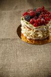 Pavlova, a home made cake from layers of meringue, whipped cream, and fresh berries Royalty Free Stock Photo