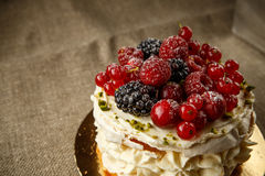 Pavlova, a home made cake from layers of meringue, whipped cream, and fresh berries Royalty Free Stock Photography