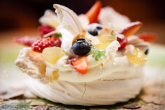 Pavlova, a home made cake from layers of meringue Stock Images