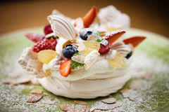 Pavlova, a home made cake from layers of meringue Royalty Free Stock Photo