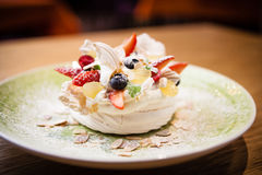 Pavlova, a home made cake from layers of meringue Royalty Free Stock Images