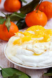 Pavlova merengue. With glazed oranges Royalty Free Stock Image