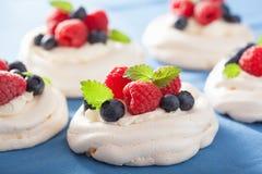 Pavlova meringue cake with cream and berry Stock Photo
