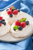 Pavlova meringue cake with cream and berry Stock Photos