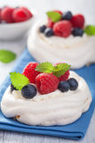 Pavlova meringue cake with cream and berry Stock Photos