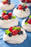 Pavlova meringue cake with cream and berry Royalty Free Stock Photo