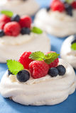 Pavlova meringue cake with cream and berry Royalty Free Stock Images