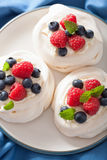 Pavlova meringue cake with cream and berry Stock Image