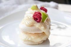 Pavlova meringue cake with custard and fresh berries. Meringue cake with custard . fresh berries and green apple stock photography