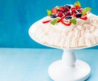 Pavlova: Meringue Whipped Cream, and Fresh Berries stock images