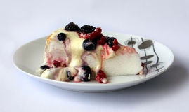 Pavlova Tart. With cream and berries on white plate Stock Photos