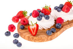 Pavlovas on olive wood board Royalty Free Stock Photo