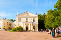 Pavlovsk Palace - summer palace of Emperor Paul I in Pavlovsk, St Petersburg , Russia and tourists walking along. Pavlovsk, St Petersburg, Russia- September 21 stock photography