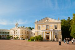 Pavlovsk Palace - summer palace of Emperor Paul I in Pavlovsk, St Petersburg Russia and tourists walking along. PAVLOVSK, RUSSIA - SEPTEMBER 21, 2017. Pavlovsk stock photos