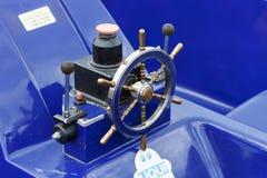 Pavlovsk Reservoir, Russia - August 10, 2018: metallic steering wheel of motor boat stock images