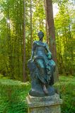 Bronze sculpture of Euterpe - the muse of music and eloquence. Old Silvia park in Pavlovsk, St Petersburg, Russia Royalty Free Stock Photo