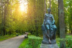 Bronze sculpture of Euterpe - the muse of music and eloquence. Old Silvia park in Pavlovsk, Saint Petersburg, Russia. Pavlovsk, St Petersburg, Russia - September Royalty Free Stock Image