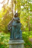 Bronze sculpture of Melpomene - muse of tragedy, with a tragic mask. Old Silvia park in Pavlovsk, Russia stock photography