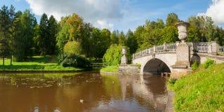 Pavlovsk, St Petersburg, Russia. Visconti bridge across Slavyanka River in Pavlovsk park. Pavlovsk, St Petersburg, Russia - September 21, 2017. The Visconti Stock Images