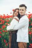 pavot de zone de couples beau Image stock